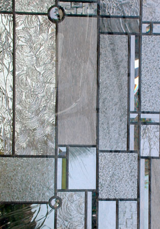 Closeup of custom abstract FLW leaded glass window