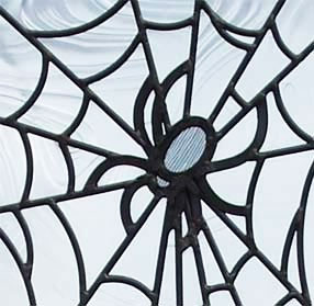 Closeup of custom leaded glass spider web window