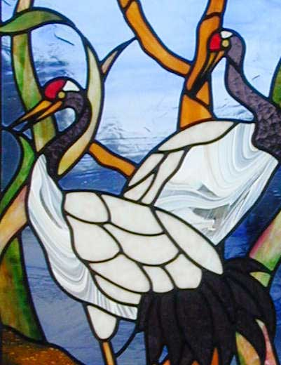 Closeup of custom stained and leaded glass oriental cranes window.