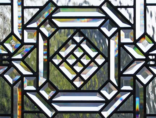 Closeup of custom leaded glass abstract pencil bevel window