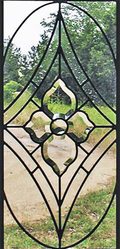 Closeup of clear leaded glass sidelight window with bevels