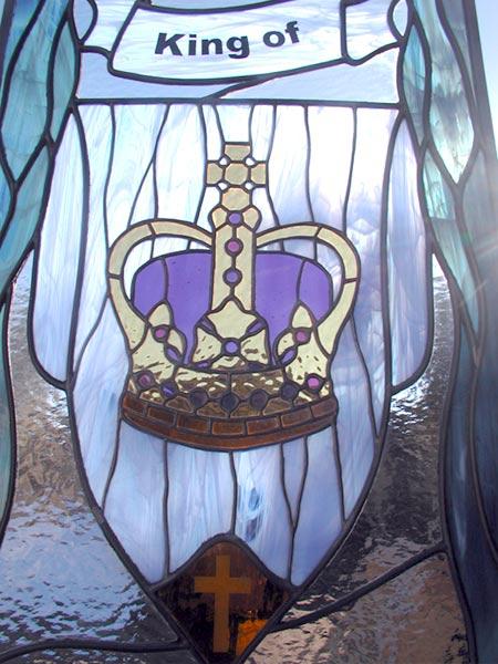 Closeup of King of Kings custom stained glass and leaded glass religious window