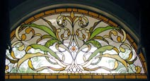 Custom stained and leaded glass arched window