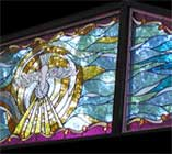 Custom stained and leaded glass window for a private chapel