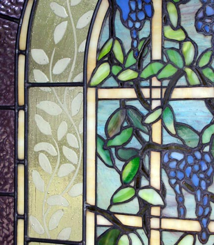 Closeup of custom stained and leaded glass Victorian style Wisteria window